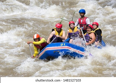 Phang Nga, Thailand - January 2017: White water rafting in Phuket, Phang Nga. Rafting down the river in a life jacket. Sports, adrenaline, good mood. People happy on vacation rafting on the river