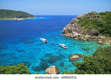 Phang Nga, Thailand - March 07, 2016: Tourists are snorkeling at the bay, located at the north part of Similan Island No. 8, photo taken from the viewpoint of Similan Island, Phang Nga, Thailand