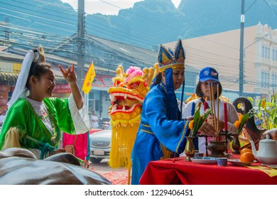 Phang Nga, Thailand - October 15, 2018: People in Chinese costume being assumed Chinese gods blessing people who pay respect to Chinese god in vegetarian festival parade in Phang Nga, Thailand