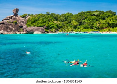 PHANG NGA,THAILAND-APRIL 16,2017: Tourists wear life jackets, are enjoying snorkeling. In front of Similan Island With very clear water In the Andaman Sea