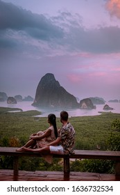 Phangnga Bay Thailand , Samet Nang She viewpoint over the bay, couple honeymoon vacation Thailand watching sunsrise