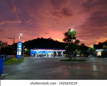 PHANGNGA, THAILAND - JUNE 03, 2019: Petroleum Authority of Thailand (PTT) service station outside of Phangnga with beautiful sky in the twilight.
