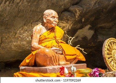 PHANG-NGA, THAILAND - MARCH 25, 2018: Traditional statue of monk in Thailand in a summer day