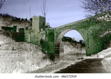 phantasmagoric landscapes in Toledo,abstract surreal landscape photography of the Alcantara bridge with flying birds over river Tagus n city of Toledo, Castilla La Mancha, Spain
