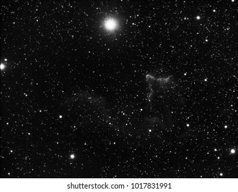 Phantom nebula or Sh2-185 in Cassiopeia constellation, big close up with special hydrogen alpha filter at telescope, over it the bright star Gamma Cassiopeiae.