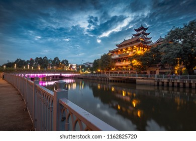"PHAP HOA PAGODA, VIETNAM - JULY 8, 2018: Night scene architecture Phap Hoa pagoda along river at night in Ho Chi Minh City, Vietnam. Translation:""Sign board Phap Hoa Pagoda"""