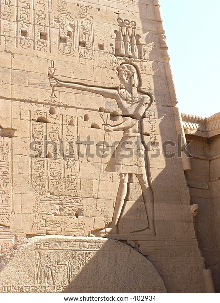 pharaoh keeping in his hand the  Flail and Crook, symbol of royalty, majesty and dominion. Philae temple, Egypt, Africa