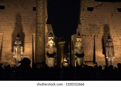 Pharaonic statues at the Luxor Temple facade in Egypt, night time