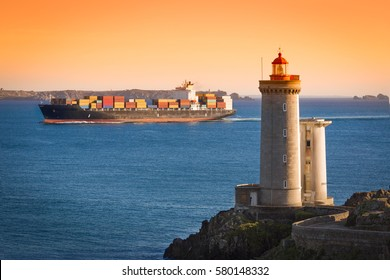 Phare du Petit Minou with container ship, Brittany, France