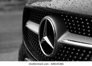 PHARE, THAILAND- JULY 6, 2016: Mercedes Benz Sign Close Up in the rain