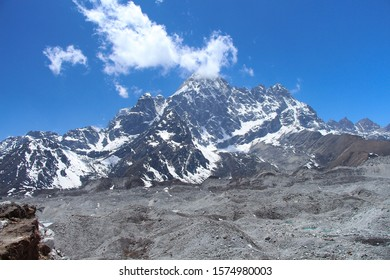Pharilapche mountain (6017 meters) rises above Ngozumpa glacier covered with stones in Sagarmatha national park in Himalayas. Route to Everest base camp through Gokyo lakes.