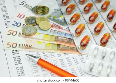Pharma medicine pills and drugs with money and pen