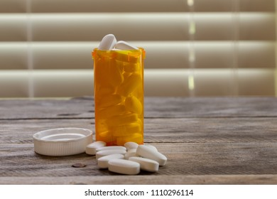 pharmaceutical opiod pills spilled out