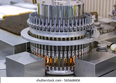 Pharmaceutical Optical Ampule/Vial Inspection Machine. Inspects vials and ampules for particulates in liquid and container defects. Pharmaceutical manufacturing.
