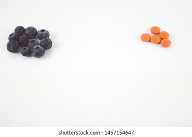 Pharmaceutical pills and medicines and fresh berries concept of healthy eating