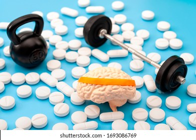 Pharmaceutical supplement for mental fitness, mind health and nootropic drugs concept with human brain with headband, barbell, kettlebell and nootropics