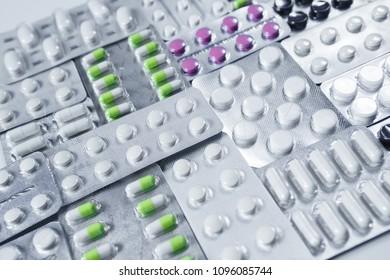 Pharmaceuticals antibiotics pills medicine. colorful antibacterials pills on white background. capsule pill medicine