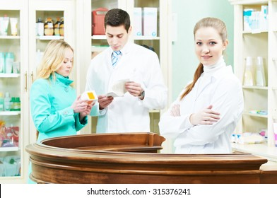 pharmacist assistance of buying medical drug to buyer in pharmacy drugstore