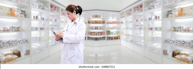 pharmacist chemist and medical doctor woman asia with stethoscope and clipboard checking medicine cabinet and pharmacy drugstore .