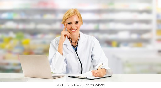 Pharmacist or doctor using laptop computer at the pharmacy room. Medical healthcare and pharmaceutical staff service.