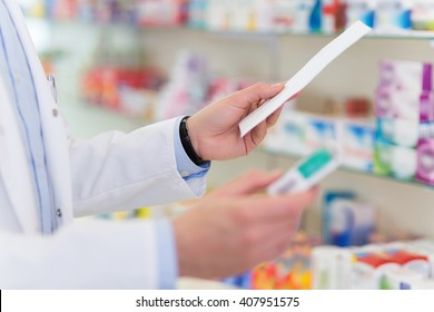 Pharmacist filling prescription in pharmacy