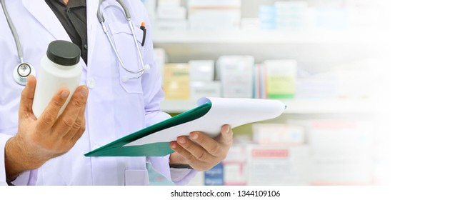 Pharmacist filling prescription in pharmacy drugstore,copy space