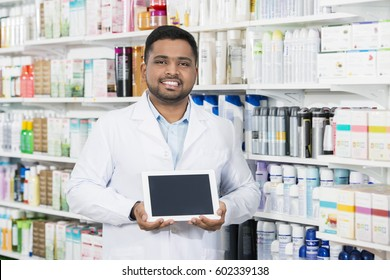 Pharmacist Holding Digital Tablet With Blank Screen