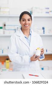Pharmacist holding a drug box in hospital