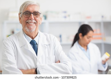 Pharmacist looking at camera with arms crossed in hospital