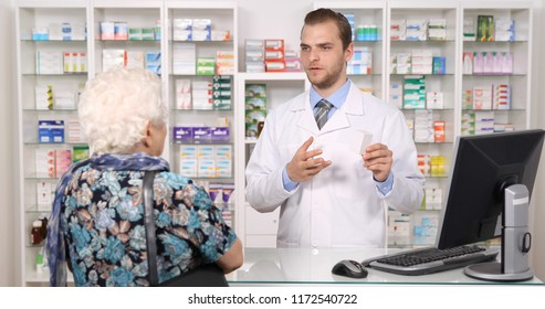 Pharmacist Man Talking with Old Woman Customer or Elderly Female Pacient About Medicine Pills in Pharmacy Shop or Drugstore Interior, Pharmaceutical Store Concept