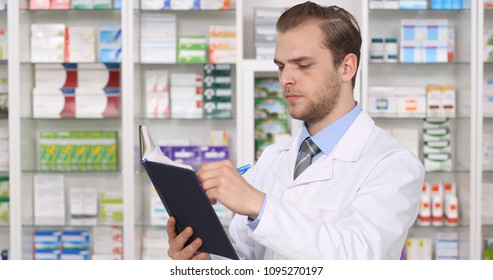 Pharmacist Man Work and Hand Writing on Agenda Important Medicine Info in Pharmacy Office, Drugstore Activity Concept
