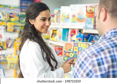 pharmacist selling a toy to a client