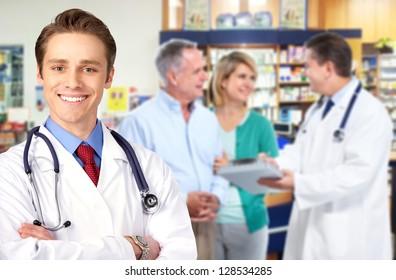 Pharmacist and a senior couple in pharmacy.