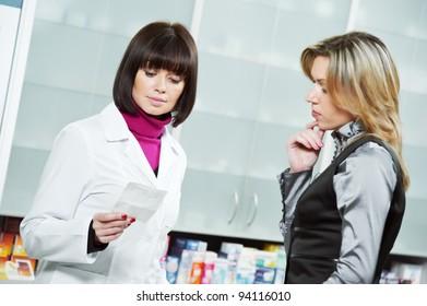 pharmacist suggesting medical drug to buyer in pharmacy drugstore