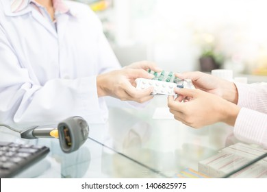 pharmacist use hand send drug strip pack to patient costumer in drugstore, safety and medication process