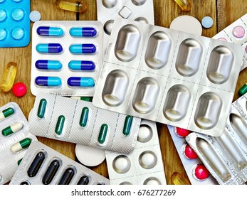 Pharmacy background. Pills on a wooden table. Medicine.