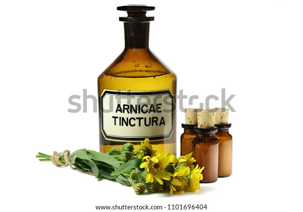 pharmacy bottle with arnica tincture isolated on white background