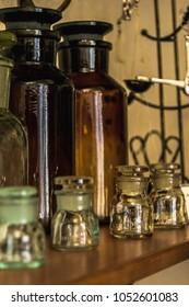 Pharmacy bottles, jars, cups the shelf in old drugstore