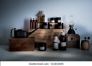 pharmacy. bottles, jars, scales a kerosene lamp on wooden shelves