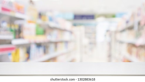 Pharmacy drugstore counter with medicine and vitamin supplement on shelves blur abstract background for montage healthcare product display
