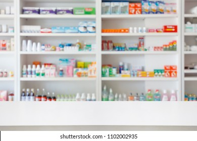 Pharmacy drugstore counter table with blur abstract backbround with medicine and healthcare product on shelves