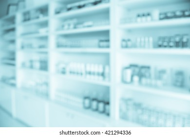 pharmacy shelves filled with medication blur background