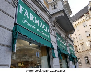 Pharmacy Shop Sign in the Street of Milan,Italy-October 2018