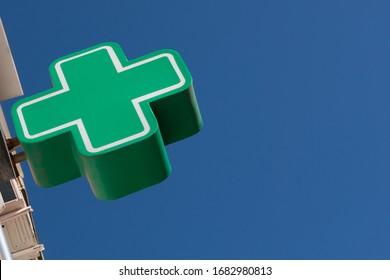pharmacy sign against the blue sky