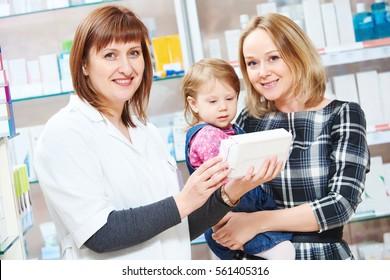 Pharmacy store. Female pharmacist portrait