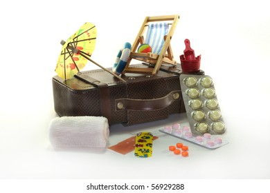 Pharmacy travel with suitcases and drugs against a white background