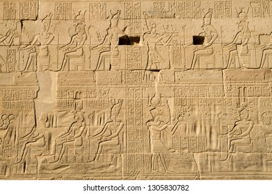 Pharoah presenting gifts for the Gods carving on wall in the temple of Isis from Philae , Egypt