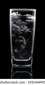 phases of pouring water cool and ice cube in glass tall on black backgrounds