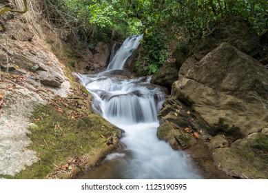 Pha-Tak waterfall in deep rain forest at Khao Laem National park, Kanchanaburi, Thailand.