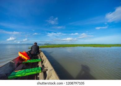 PHATTHALUNG, THAILAND - 8th OCT 2018; Tourist enjoying a morning view of lake Thale Noi, Phatthalung, Thailand.
